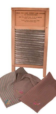 Antique washboard with vintage embroidered silk handkerchiefs Stock fotó