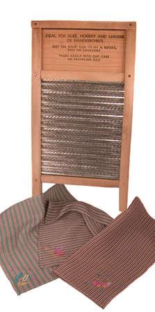 handkerchiefs: Antique washboard with vintage embroidered silk handkerchiefs Stock Photo