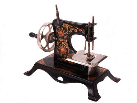 crank: Adornado altamente negro m�quina de costura inestable de juguete de todo el ni�o antiguo de acero Foto de archivo