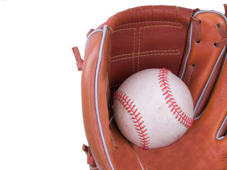 hardball: A baseball being caught in a right handed baseball glove
