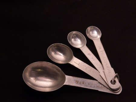 Set of four vintage aluminum measuring spoons Imagens - 798026