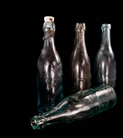 Antique glass beer bottles, one complete with its original ceramic stopper. Stock Photo