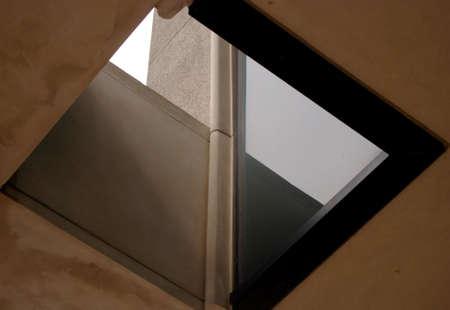 Outdoor Skylight in sidewalk overhang.