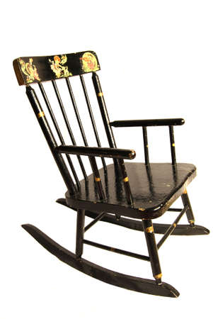 enameled: Early 20th century black enameled, stenciled childs rocking chair Stock Photo