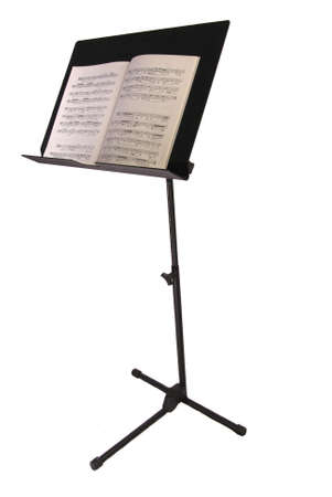 Black metal music stand holding a music lesson book, isolated. Reklamní fotografie - 1481324