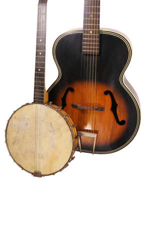 Antique banjo and vintage guitar on a white isolated background.