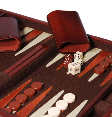 Detail view of portable backgammon game board and pieces. Stock Photo