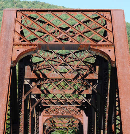 superstructure: View of old rusty railroad bridge superstructure. Stock Photo