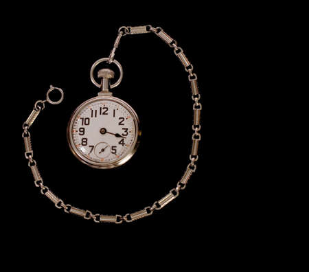 Old pocketwatch, no minute hand, cracked crystal.