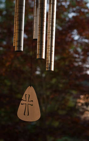 View Of Wind Chimes With Christian Theme Stock Photo
