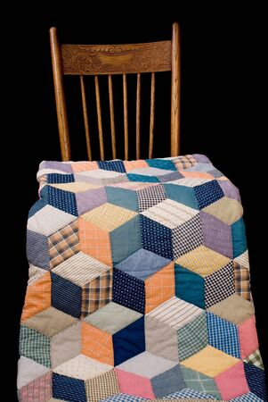Late nineteenth century quilt and chair, black iso. Reklamní fotografie - 4156471