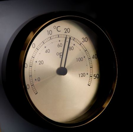 Drama light view of analog thermometer, black iso.