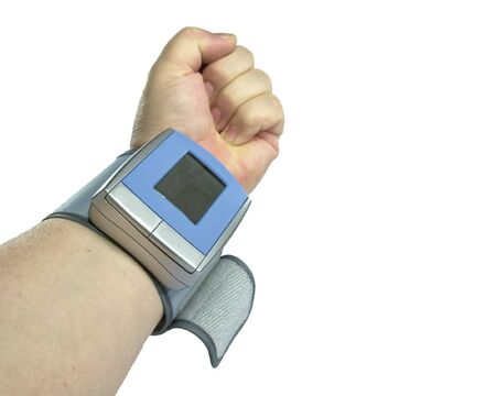 View of forearm with blood pressure cuff attached, white isolation.
