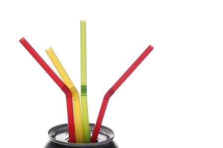 Four colorful drinking straws in a beverage can, white isolation. Reklamní fotografie