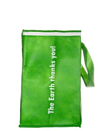 Green, woven paper,  reusable grocery shopping bag, white iso. Reklamní fotografie - 8130738