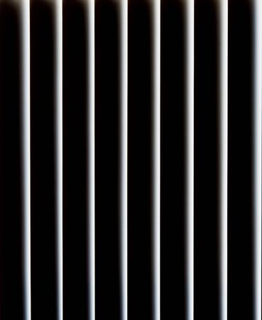 Monochrome view of vertical white bars with black spaces.