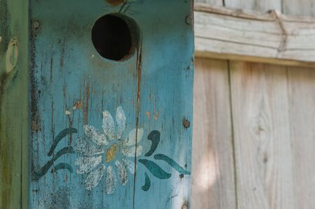 Close-up of old, weathered, cracked bird house, copy space on right.
