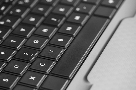 Close-up view of computer keyboard, focus on  fv keys, monochrome. Reklamní fotografie