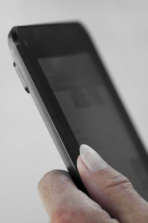 Close up view of female hand holding an electronic tablet
