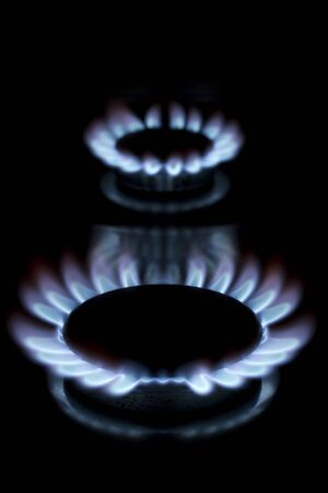 Two lit gas burner rings Stock Photo