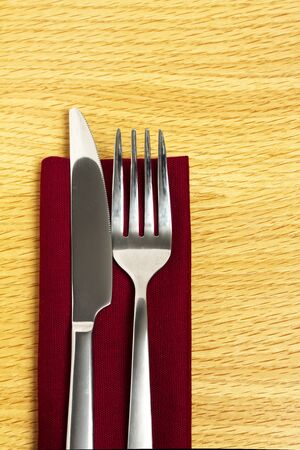 Knife and fork on red napkin photo