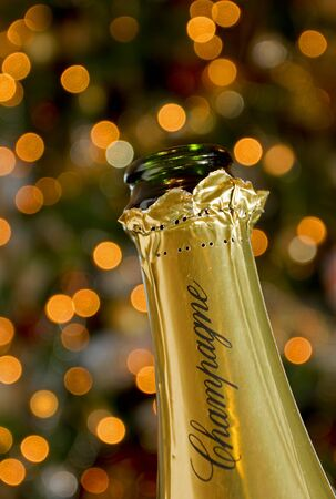 Champagne bottle on christmas sparkly background  Stock Photo