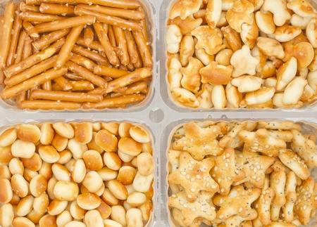 Plastic box with assorted salted snacks photo