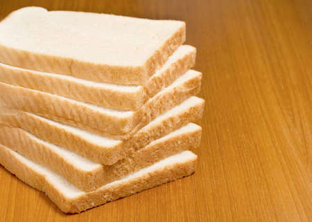 Stack of sliced white bread photo