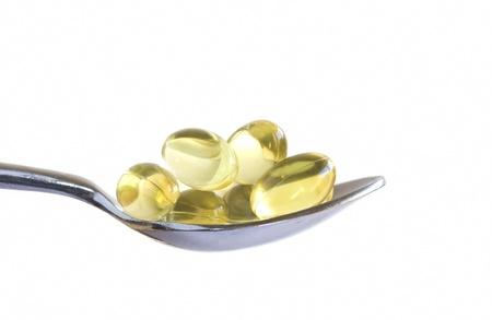 spoon yellow: Teaspoon full of cod liver oil