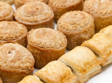Pork pies and sausage rolls Stock Photo