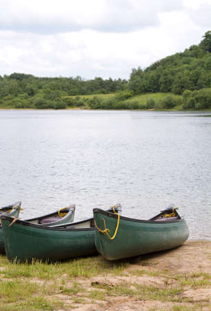 Canoes by shore of lake photo