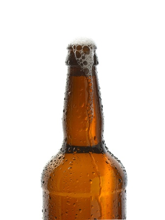 Ice cold open bottle of refreshing beer photo