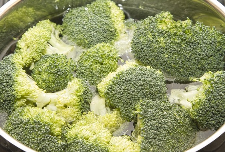 Pan of broccoli and water ready to cook photo
