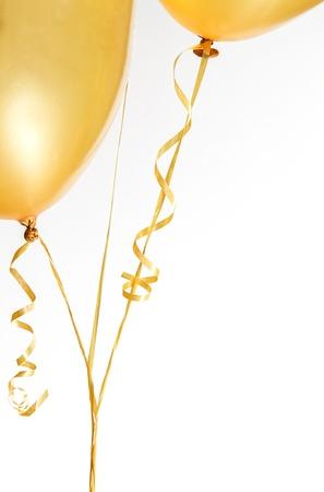 Balony zÅ'ota i Wstążki na biaÅ'ym tle Zdjęcie Seryjne