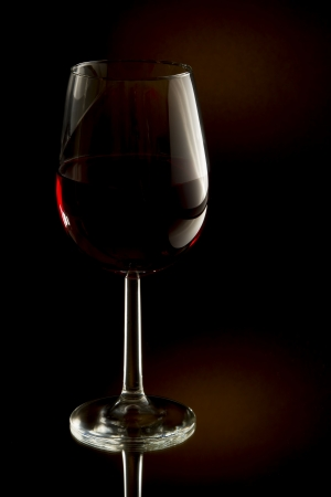 Low key image of red wine in a glass