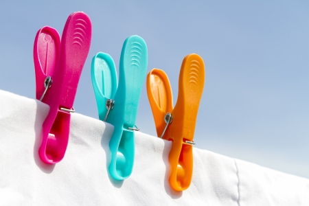 Three clothes pegs on a line photo