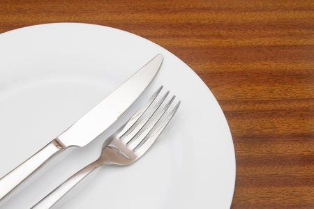 White place setting on wooden table photo
