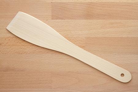 Wooden spatula on a chopping board