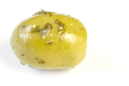 pitted: One green olive with herb dressing on white
