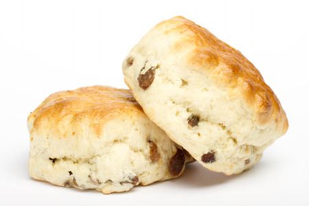 sultanas: Two fruit scones on a white background Stock Photo