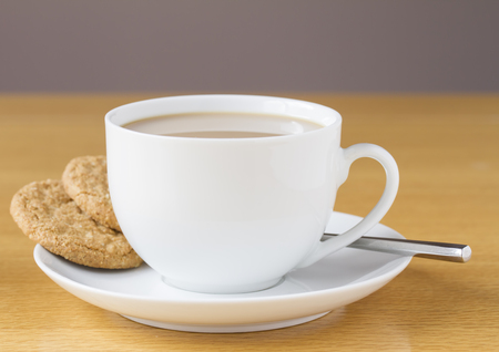 tea spoon: Cup of tea with two cookies