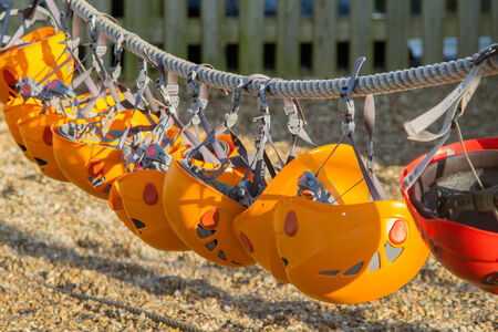 Row of orange climbing helmets