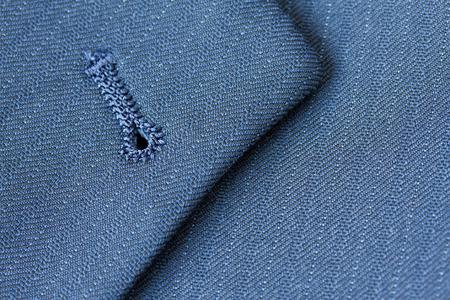 buttonhole: Close up detail of buttonhole on suit lapel
