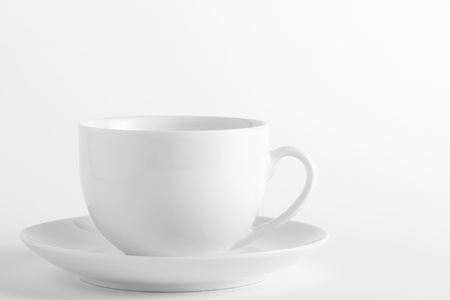 White cup and saucer on a white background Stock Photo