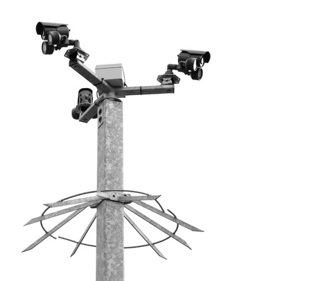 metal post: Security cameras on a spiked metal post