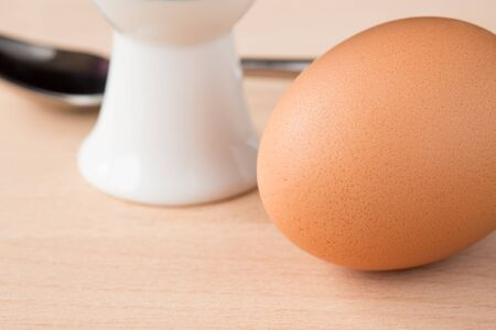 eggcup: Single brown egg with eggcup and spoon Stock Photo