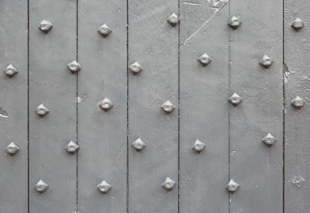 close up image: Close up image of old grey painted wooden door