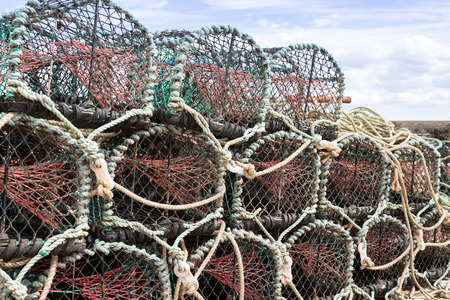 lobster pots: Lobster or crab pots stacked on jetty