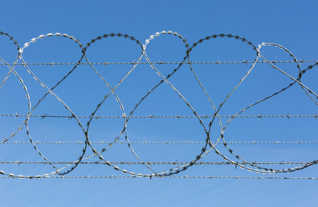 barbed wire fence: Barbed and razor wire security fence