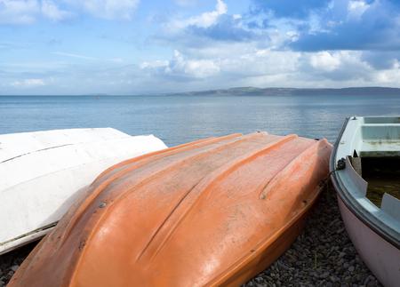stoney: Upturned boats on a stoney beach